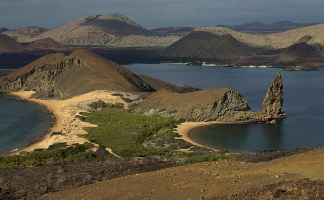The Galapagos Islands, view of Santiago Island from Bartolome Island