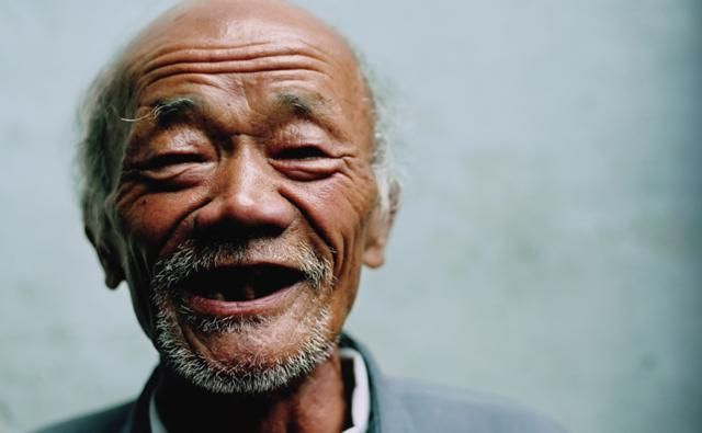 Portrait of an elderly man smiling