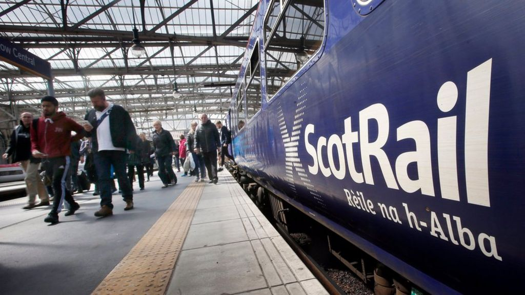 A ScotRail train is pictured in a station as commuters disembark