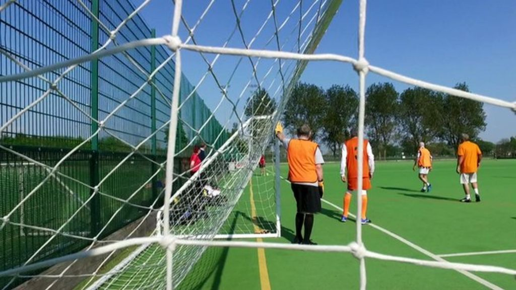 How 'walking football' is helping men with mental health problems - BBC News