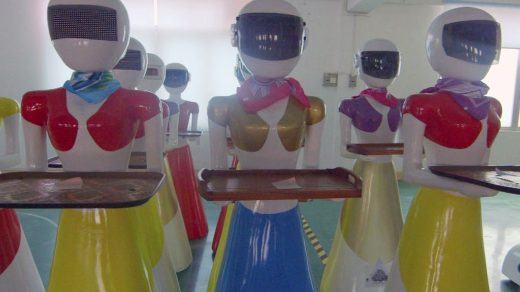 Inside a factory making robot waiters and waitresses