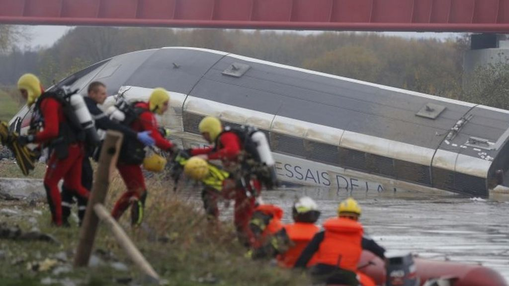 Rescue workers - including divers - search the wreckage of the TGV train near Strasbourg. Photo: 14 November 2015