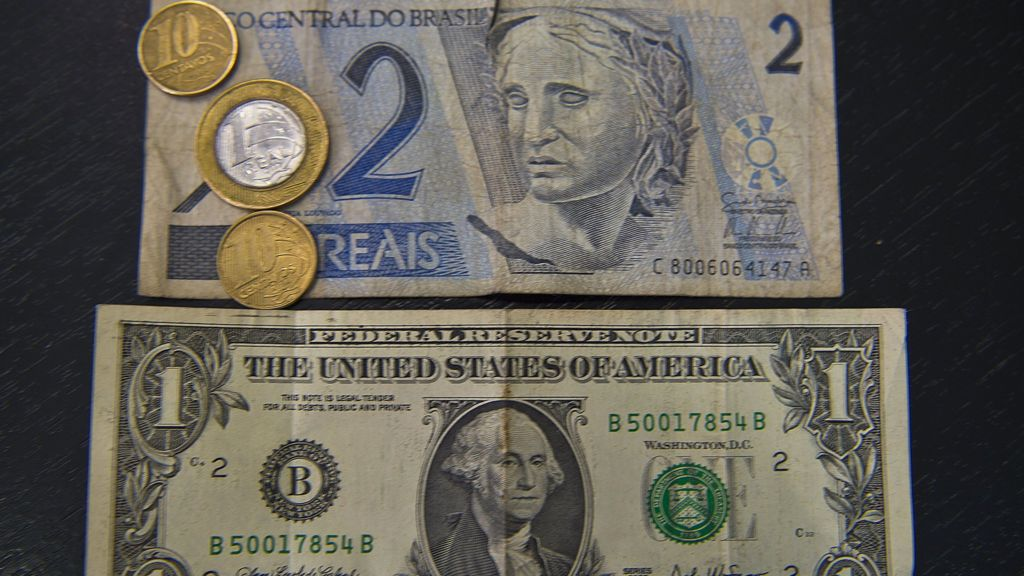 Brazilian real weakens to nearly 4 reais to the dollar - BBC News