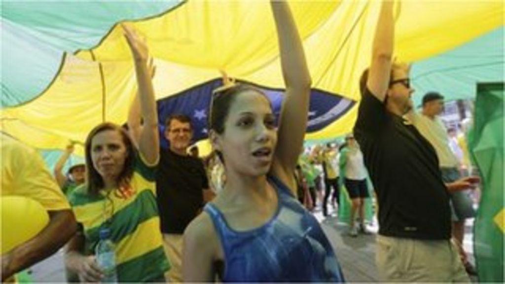 Protesters flood Brazil's Copacabana beach - BBC News