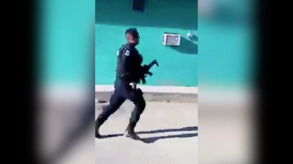 Video of police 'fleeing' crime scene before murder goes viral - BBC ...