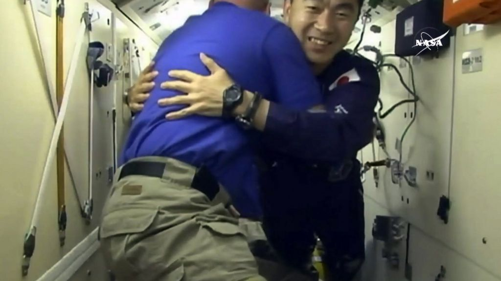Astronauts dock at the International Space Station - BBC News