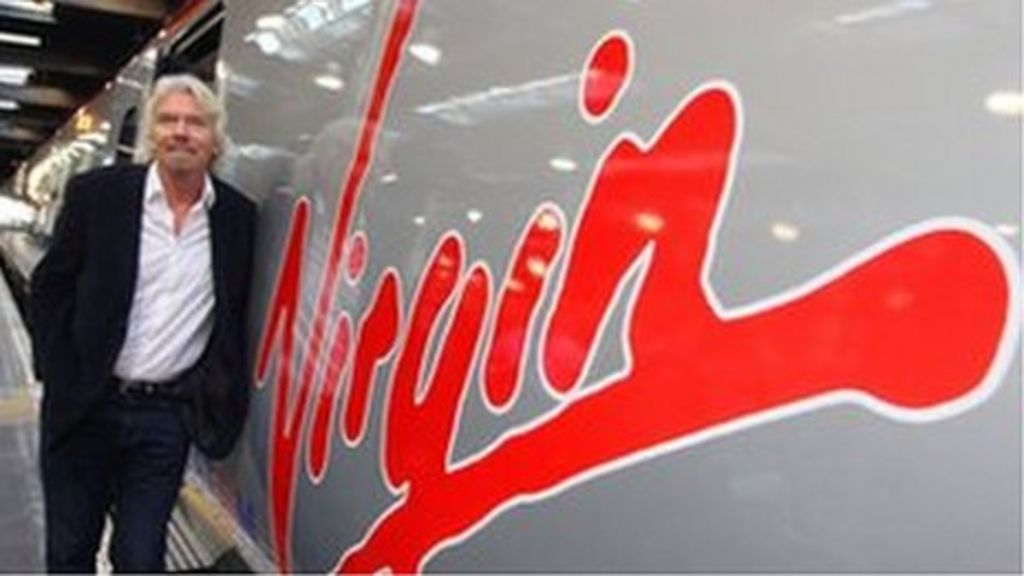 Sir Richard Branson next to a Virgin Pendolino train