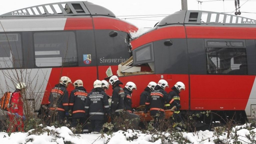 Emergency services remove an injured person from a train wreck near Vienna