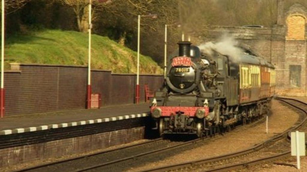 A steam train running on the railway