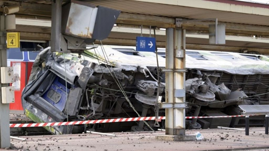 A derailed carriage at the site of a train accident in the railway station of Bretigny-sur-Orge on 12 July 2013 near Paris in France