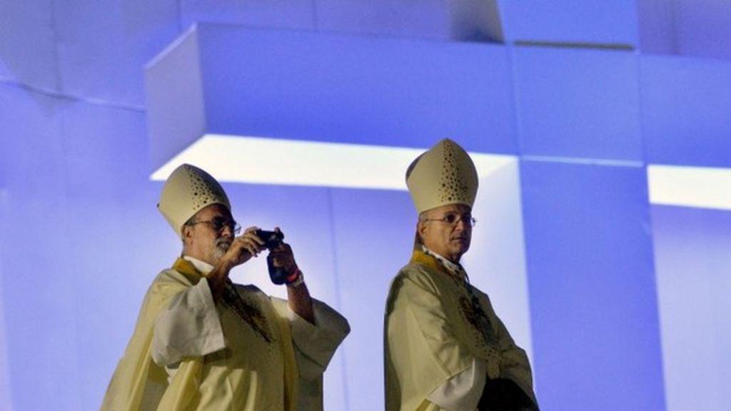 1:46 Catholics attend Copacabana Mass 24 July 2013