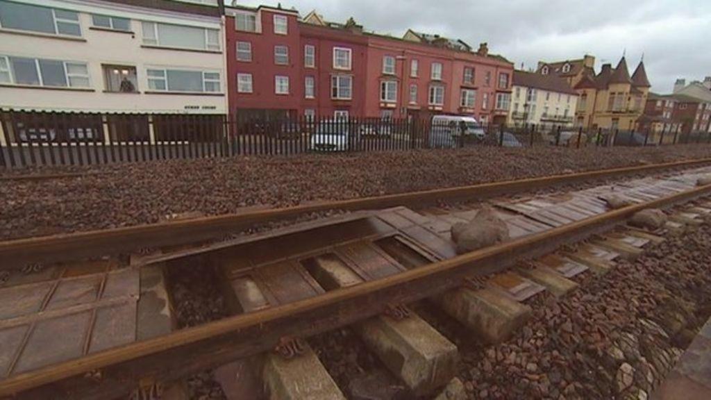 Damaged rail line at Dawlish.