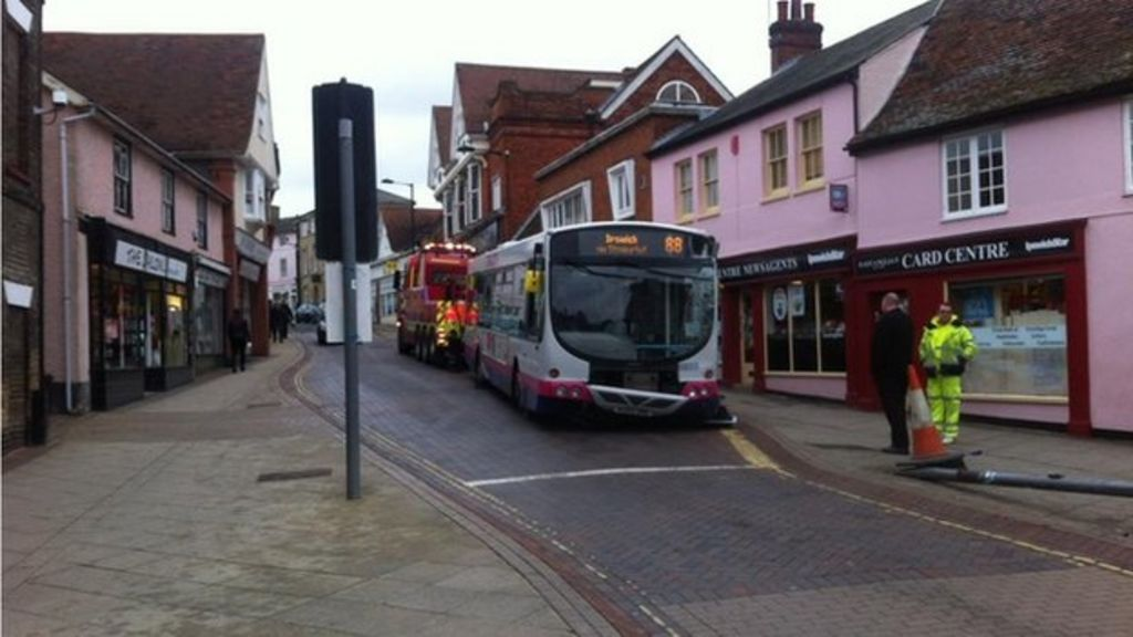 Bus crashes into stowmarket shop as driver buys newspaper bbc news