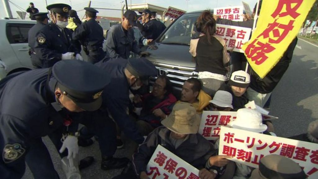 Okinawa residents protest over new US military base - BBC News