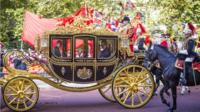 Queen Elizabeth II and China's President Xi Jinping travel together in the Diamond Jubilee State Coach along the Mall to Buckingham Palace in central London on October 20, 2015