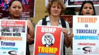Members of New Socialist Alternative Indian section of the committee for the workers international fighting for Democratic Socialism holds placards and shouts slogans against the newly sworn United States of American President Donald Trump in Bangalore