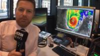 Tomasz Schafernaker shows a rain map of Hurricane Nicole