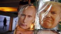 Face masks depicting Russian President Vladimir Putin and U.S. President-elect Donald Trump hang for sale at a souvenir street shop in St.Petersburg, Russia, on 23 December 2016.