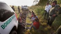 Border Patrol agents detain undocumented immigrants apprehended along the Mexican border near McAllen, Texas, on 28 May 28, 2010
