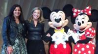 Anne Hidalgo (L) celebrating with Mickey and Minnie Mouse at the Eiffel Tower in Paris