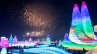 Harbin Ice and Snow Festival with fireworks in the background