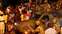 Senegalese troops secure area near state house in the Gambian capital Banjul Sunday Jan. 22, 2017
