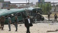Afghan security forces inspect the site of a suicide attack on the outskirts of Kabul, Afghanistan, Thursday, 30 June 30 2016.