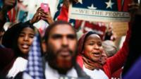"People take part in a rally called ""I Am A Muslim Too"" in a show of solidarity with American Muslims at Times Square on 19 February 2017 in New York City"
