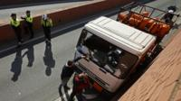 Police in Barcelona inspect a truck