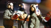 One of the three children survivors pulled out of the Rigopiano Hotel arrive by helicopter at the airport in Pescara, Abruzzo region, Italy, 20 January 2017