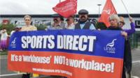 Unite union members outside Sports Direct's Annual General Meeting at their headquarters in Shirebrook, 9 September 2015