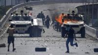 Protestors attack National Guard vehicles