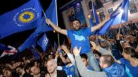 Supporters of ruling Georgian Dream party take part in rally in Tbilisi, Georgia, Saturday, Oct. 8, 2016