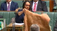 Linda Burney displays her traditional kangaroo-skin cloak at the House of Representatives in Canberra