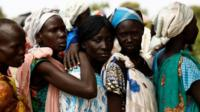 Women queue for food in the South Sudanese village of Rubkuai in Unity State, 16 February 2017