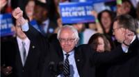 US Democratic presidential candidate Bernie Sanders reacts on stage during a primary night rally in Concord, New Hampshire, on February 9, 2016