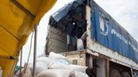 A truck from the World Food Programm (WFP) delivers bags of food