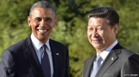 US President Barack Obama is greeted by Chinese President Xi Jinping for a bilateral meeting in Saint Petersburg on 6 September, 2013 on the sidelines of the G20 summit