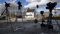 Television cameras stand on the road across from the house of nurse Kaci Hickox in Fort Kent, Maine 30 October 2014
