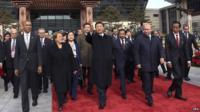 A handout picture released by Xinhua shows Chinese President Xi Jinping walk to plant trees with other leaders and representatives from the Asia-Pacific Economic Cooperation to mark friendship in the APEC family in Beijing, China on 11 November 2014
