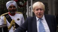 London Mayor Boris Johnson is met by Doorman, Narajan at Raffles Hotel in Singapor