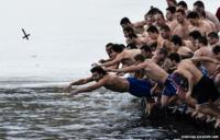 Bulgarians dive into the icy waters in Sofia as part of Epiphany Day celebrations
