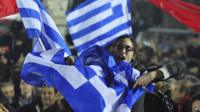 Crowd celebrates Syriza victory in Greece, waving flags