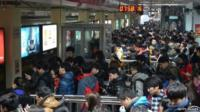 People wait for a subway at Sihui East Station during the first weekday after the subway adopted a new fare policy on 29 December 2014 in Beijing, China