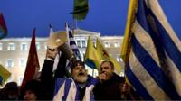 Residents waving Greek flags gather on Syntagma square