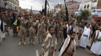 Shia rebels, known as Houthis, hold up their weapons to protest against Saudi-led airstrikes, as they chant slogans during a rally in Sanaa, Yemen
