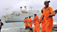 Workers haul part of a fibre optic cable onto the shore at the Kenyan port town of Mombasa in 2009, bringing internet connectivity from the United Arab Emirates