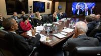 A handout picture released by the White House on 1 April 2015 shows US President Barack Obama (L) and Vice President Joe Biden (R), with the national security team, participate in a secure video teleconference from the Situation Room of the White House in Washington.