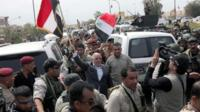 Iraqi Prime Minister Haider al-Abadi waves an Iraqi flag in Tikrit (1 April 2015)