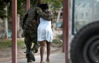 A Kenyan soldier escorts a woman after she was rescued